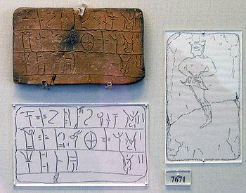 Un ejemplo de escritura lineal B, con una copia abajo de los signos de la tablilla