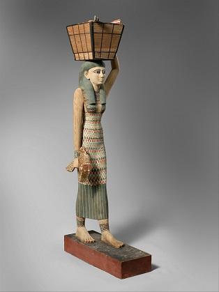 Estatua de una mujer portando ofrendas. 2020 a.C. Tumba 280 de Tebas. Museo metropolitano de arte de Nueva York